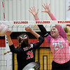 Webb City's Ashley Cates, right, gets the block on Carl Junction's Salma Lewis during their match on Tuesday night at CJHS.<br /> Globe | Laurie SIsk
