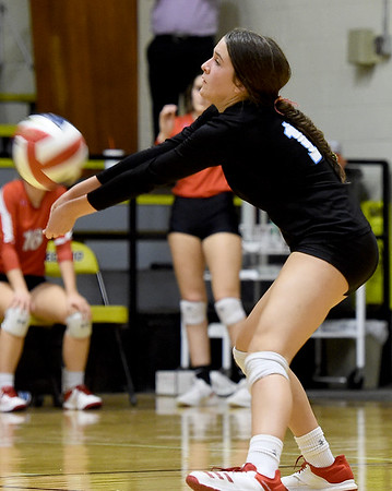 Webb City libero Sage Crane passes a Carl Junction serve during the championship game of the Class 4 District 11 tournament on Tuesday night at Neosho High School.<br /> Globe | Laurie Sisk