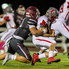 Joplin's Isaiah Davis (20) tackle's Nixa's Reid Potts behind the line of scrimmage during their Senior Night game on Friday evening at Junge Field in Joplin.<br /> Globe|Israel Perez