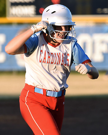 Webb City pitcher Haidyn Berry celebrates her two-run home run during the Cardinals Class 4 District 11 semifinal gamea gainst Carthage on Thursday at Carthage.<br /> Globe | Laurie Sisk