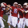 Webb City's Cale McCallister (15) celebrates his interception against Ozark during Friday's game in Webb City.<br /> Globe | Roger Nomer