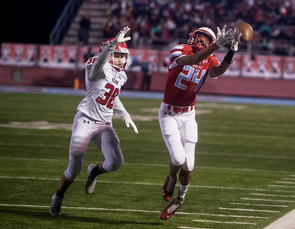 Webb City's Mekhi Garrard reaches out for a pass as Ozark's Hunter Johnson defends during Friday's game in Webb City.<br /> Globe | Roger Nomer