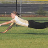 Globe/Roger Nomer<br /> Neosho's Emily Harrell stretches out but can't reach a pop fly during Wednesday's game against Neosho.