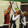 Globe/Roger Nomer<br /> College Heights' Alex Bruey, center, and Caitlin Good make a block against an Ash Grove player (note #21 not listed in roster) during Monday's match.
