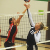 Globe/Roger Nomer<br /> College Heights' Alex Bruey blocks a hit from Ash Grove's Abby Arico during Monday's match.