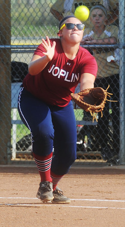 Globe/Roger Nomer<br /> Joplin's Ashlie Green tries to get under a pop up during Wednesday's game against Neosho.