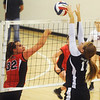 Globe/Roger Nomer<br /> College Heights' Hannah Fuller blocks a hit from Ash Grove's Halee Cashio during Monday's match.