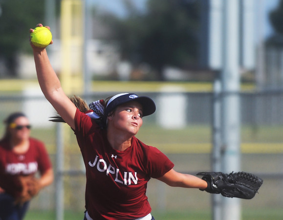 Globe/Roger Nomer<br /> Joplin's Michaela Sennett winds up for a pitch against Neosho on Wednesday.