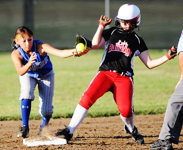 Carl Junction's Shelby Sullivan barely makes it to second base ahead of the Carthage second baseman's tag Monday evening, Sept. 30, 2013, at Carl Junction's softball field. The runner was called safe. Globe | T. Rob Brown