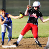 Carl Junction's Shelby Sullivan barely makes it to second base ahead of the Carthage second baseman's tag Monday evening, Sept. 30, 2013, at Carl Junction's softball field. The runner was called safe.<br /> Globe | T. Rob Brown