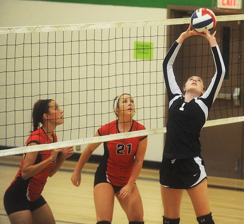 Globe/Roger Nomer<br /> College Heights' Sarah Kent sets the ball against Ash Grove during Monday's match.