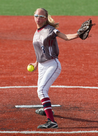 Joplin's Aydan Perrin throws from the circle during the Eagles game against McDonald County on Tuesday at JHS.<br /> Globe | Laurie Sisk