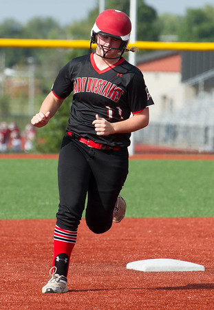 McDonald County's Kylie Helm rounds the bases after a two-run home run over deep center during the Mustangs game against Joplin on Tuesday at JHS.<br /> Globe | Laurie Sisk