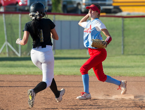 Webb City's Kaylee Cristy gets the force out on Neosho's Logan Bates (1) during their game on Thursday night at WCHS.<br /> Globe | Laurie Sisk