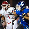 Carthage running back Clay Newman (9) looks for running room as Carl Junction's Kitch Channel (1) closes in during their game on Friday night at Carthage.<br /> Globe | Laurie Sisk