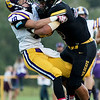 Globe|Israel Perez<br /> Christian Garrison from Sarcoxie tackles Christian Maturino from Diamond during their game on Friday night at Diamond High School.