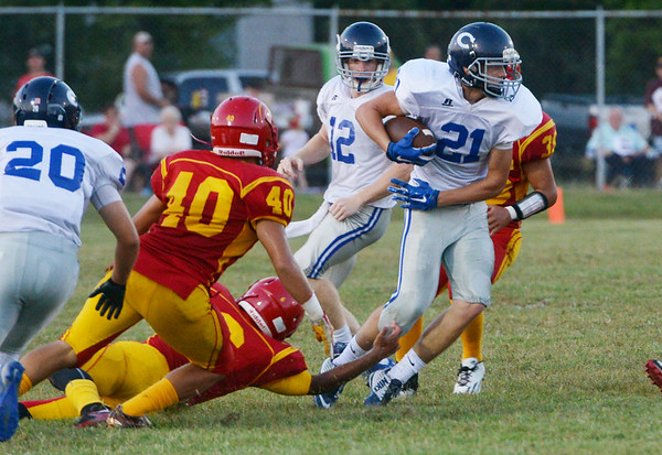 Globe/Roger Nomer<br /> St. Mary's Colgan's Max Wilson runs the ball against Columbus on Friday night in Columbus.