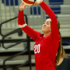 Webb City's Abby Brownfield (20) sets the ball during the Cardinals' match against Joplin on Tuesday night at JHS.<br /> Globe | Laurie Sisk