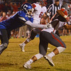Globe/Roger Nomer<br /> Carthage's Arkell Smith tries to tackle Nixa's Nicos Oropeza during Friday's game in Carthage.
