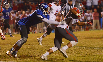 Globe/Roger Nomer Carthage's Arkell Smith tries to tackle Nixa's Nicos Oropeza during Friday's game in Carthage.