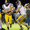 Globe|Israel Perez<br /> Quaterback Chris Comerford (1) from the Sarcoxie Bears does a ball fake with Devon Middleton (2) during their game on Friday night against Sarcoxie at Diamond High School.