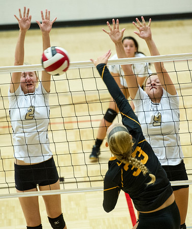Neosho's Brianna Keho (2) and Kelly Johnson (9) try to block a spike by Lebanon's Cori Johnson (330 during pool play at the Dr. Jeffrey Knutzen CJ Classic on Saturday at Carl Junction.<br /> Globe | Laurie Sisk