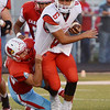 Globe/Roger Nomer<br /> Webb City's Trey Gibson brings down Ozark's Jack Hulse during Friday's game in Webb City.