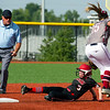 McDonald County's Hannah Schmit slides under the tag of Joplin shortstop Kinsley Stewart during their game on Tuesday at JHS.<br /> Globe | Laurie Sisk