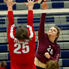 Joplin's Sara Benson (20) battles Webb City's Madi Ferguson (25) at the net during their match on Tuesday night at JHS.<br /> Globe | Laurie Sisk