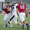 Joplin's Spencer Newell (4) works to get past Lebanon's Marty Rumfelt (32) during their game on Friday night at Junge Stadium.<br /> Globe | Laurie Sisk