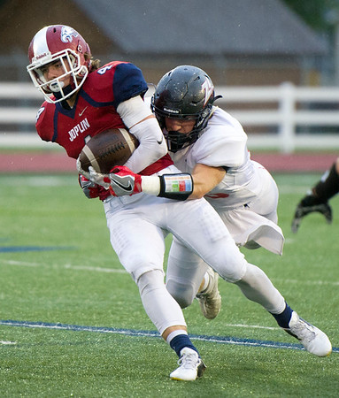 Eagles receiver Spencer Newell works to get past West Plains defensive lineman Mason Wilbanks during their game on Friday night at Junge Stadium. <br /> Globe   Laurie Sisk