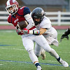 Eagles receiver Spencer Newell works to get past West Plains defensive lineman Mason Wilbanks during their game on Friday night at Junge Stadium. <br /> Globe | Laurie Sisk