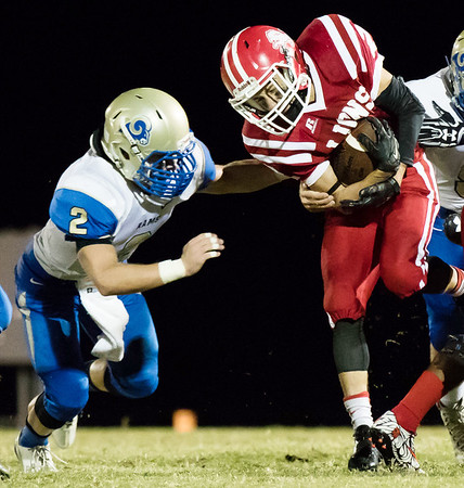 Globe|Israel Perez<br /> Baxter Springs Donovan Anderson (2) gets tackle by Riverton's Jacob McCorkle (2) during their game on Friday night at Baxter Springs High School.
