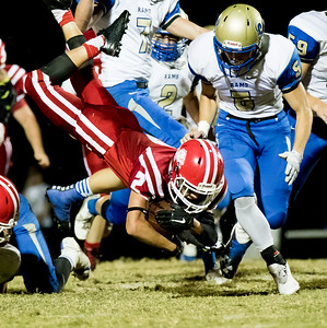 Globe|Israel Perez Baxter Springs' Donovan Anderson (2) takes a dive for extra yards during their game on Friday night against Riverton at Baxter Springs High School.