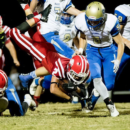Globe Israel Perez<br /> Baxter Springs' Donovan Anderson (2) takes a dive for extra yards during their game on Friday night against Riverton at Baxter Springs High School.