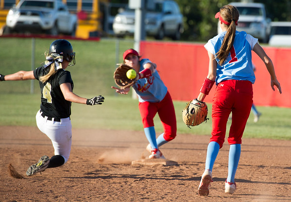 Webb City second baseman Kaylee Cristy (1) watches her flip to shortstop Bri Nichols as Neosho's Kaylee Johnson (4) slides into second base during their game on Thursday night at WCHS.<br /> Globe | Laurie Sisk