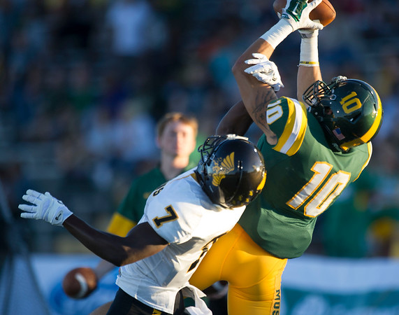 Missouri Southern receiver Jordan Morrison (10) draws the interference call against Missouri Western defensive back Brandin Dandridge (7) during their game on Saturday night at Fred G. Hughes Stadium.<br /> Globe | Laurie Sisk