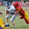 Globe/Roger Nomer<br /> Columbus' Ridge Smith wraps up St. Mary's Colgan's Billy Dickey during Friday's game in Columbus.
