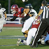 Joplin defensive end Nate Daugherty (94) looks for extra yards on a fumble recovery as Lebanon's Hunter Bray (27) works to bring him down during their game on Friday night at Junge Stadium.<br /> Globe | Laurie Sisk