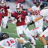Joplin receiver Spencer Newell (4) looks for room up the middle as West Plains defensive back Taylor Cornish (84) pursues during the Eagles' game against the Zizzers on Friday night at Junge Stadium. Also pictured is Joplin's Gavin Merriman (12) and West Plains' Justin Nichols (16.)<br /> Globe | Laurie Sisk