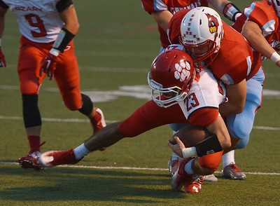 Globe/Roger Nomer Webb City's Trey Gibson tackles Ozark's Curt Gracey during Friday's game in Webb City.