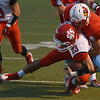 Globe/Roger Nomer<br /> Webb City's Trey Gibson tackles Ozark's Curt Gracey during Friday's game in Webb City.