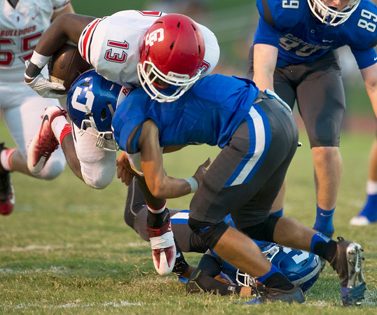 Carl Junction running back Rayquion Weston (13) tries to get past Carthage defensive back Dillon Lancaster (21)) during their game on Friday night at Carthage.<br /> Globe | Laurie Sisk