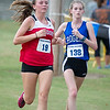 Carl Junction's xx xxx and Rogers xx xxx battle near the finish line on Thursday at the Carthage Invitational in Carthage.<br /> Globe | Laurie Sisk