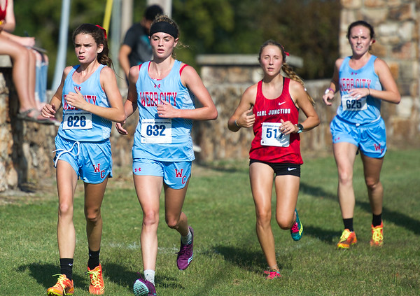 From the left: Locla athletes xxx (626), xx (632), xx (517) and xx (625) compete in the girls division of the Carthage Invitational Cross Country meet on Thursday at the Carthage Golf Course.<br /> Globe | Laurie Sisk