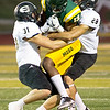 Missouri Southern receiver Kene Anigbogue (13) battles for extra yards as Emporia State's Remington Whitley (31) and AJ West (28) defend during their game on Saturday night at Fred G. Hughes Stadium.<br /> Globe | Laurie Sisk