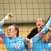 Web City's Madeline Hayes (12) and Allary Liberatore can't catch up to a Carl Junction spike during their match on Tuesday night at Webb City.<br /> Globe | Laurie Sisk