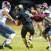 Neosho's Jarvis Funk (4) tries to get past Logan-Rogersville's Jarrett Stiles (81) and Brock Carter (3)  during their game on Friday night at Neosho.<br /> Globe   Laurie Sisk