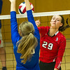 Carl Junction's Grace Southern (29) battles Grainville's Sydney Wiedenmann (18) at the net during a semifinal match of the Dr. Jeffrey Knutzen CJ Classic Volleyball Tournament on Saturday at CJHS.<br /> Globe | Laurie Sisk
