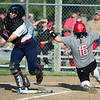 Carl Junction's Emme Beaver slides home safely as Joplin catcher Mikayla Kuehnel fields the throw during their game on Wednesday at CJHS.<br /> Globe | Laurie Sisk